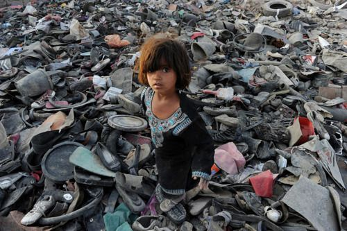 An Afghan girl scavenges for recyclable items on the outskirts of Kabul, on October 4, 2011.