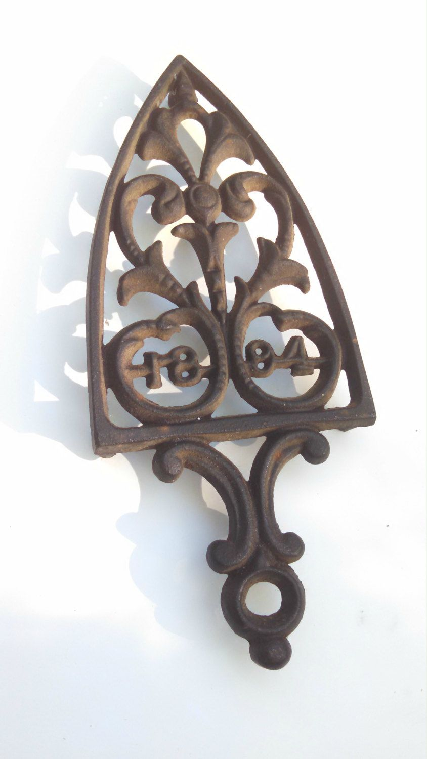 1894 Cathederal Cast Iron Trivet by TPSVintage on Etsy