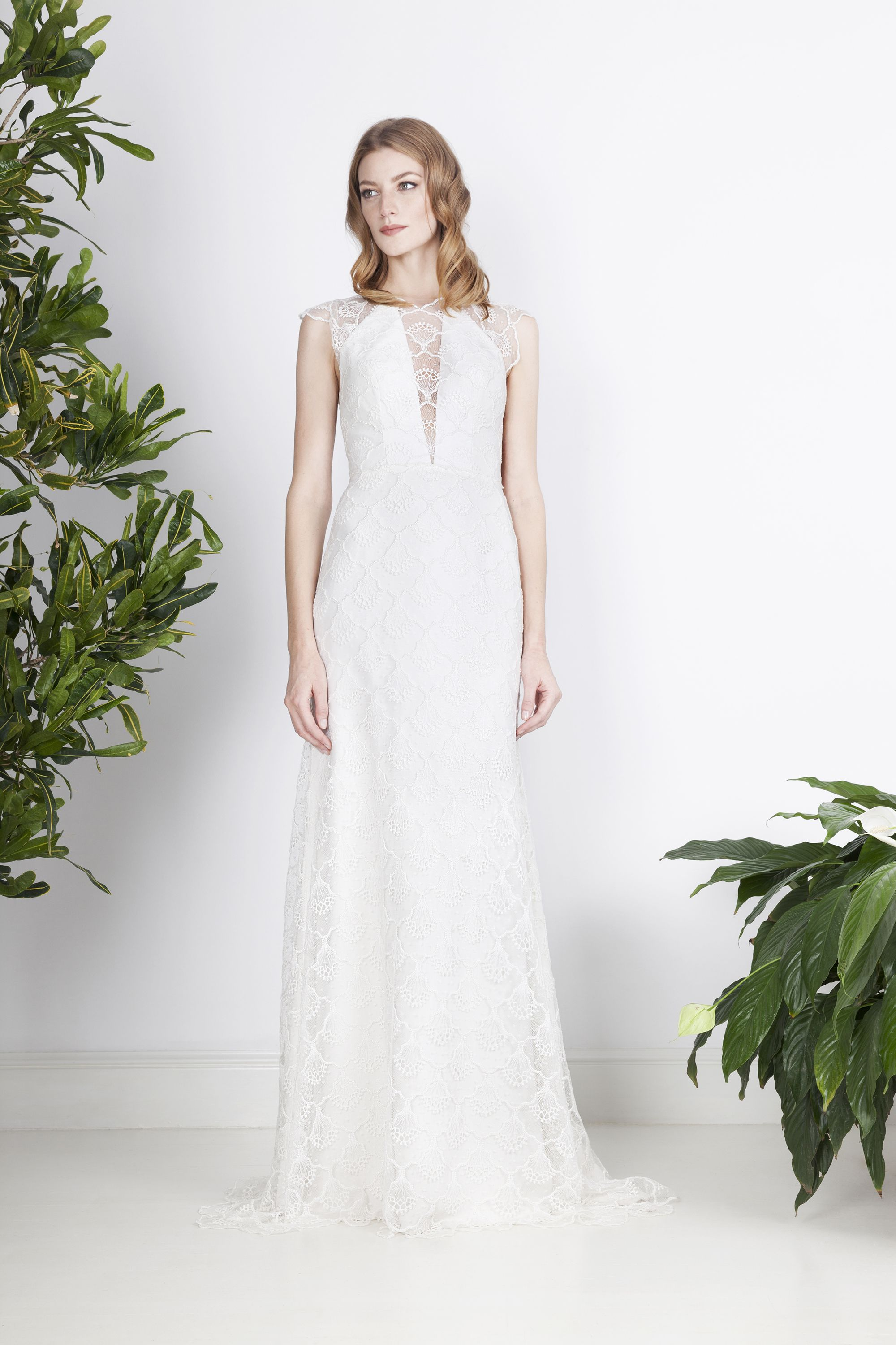 Fluid, minimalist wedding dress made of French lace with an illusion ...
