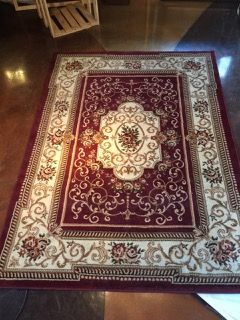 5x8 Foot Red Wine Colored Area Rug With Gold Scrollwork And Center Medallion