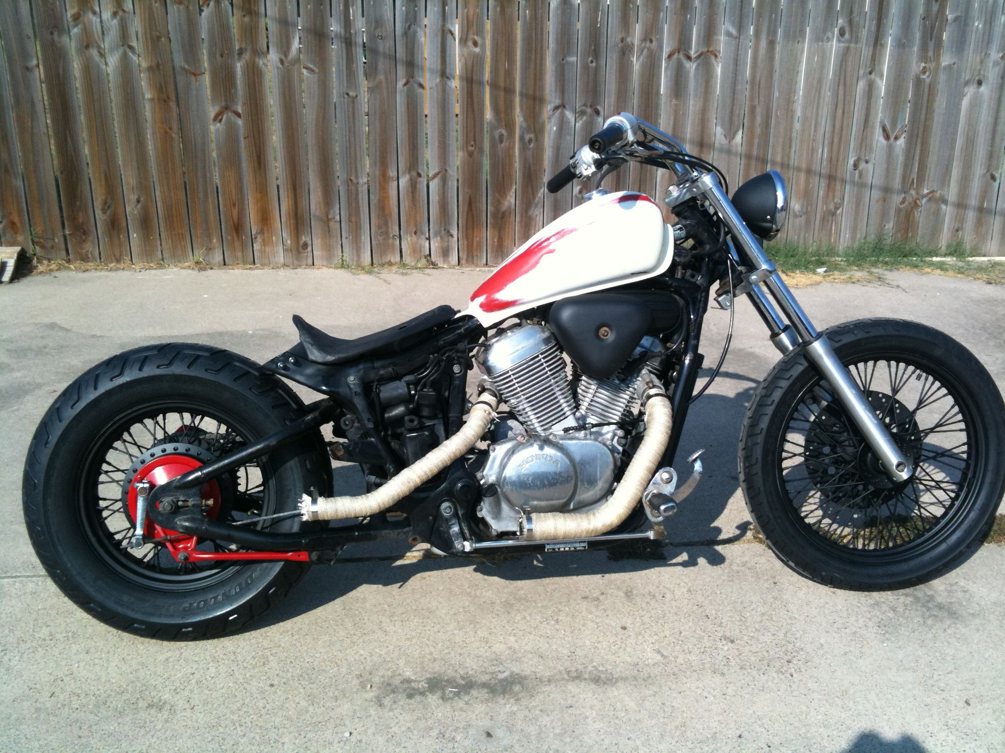 Check out this black, red and white Honda Shadow Bobber Motorcycle. This  bike will be the envy of Main Street USA