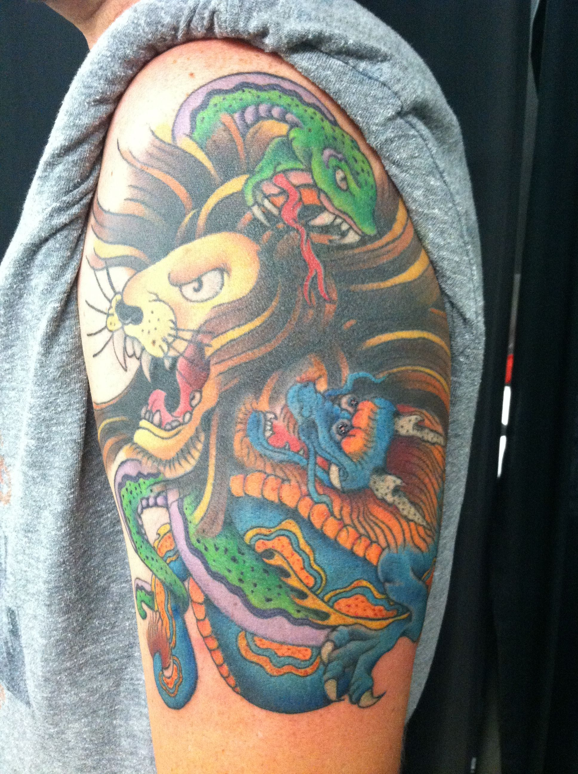 Lion snake n dragons oh my!! done at All Hallows' Ink n