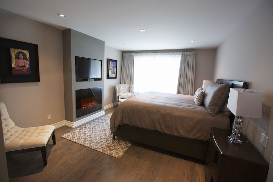 bedroom design  colleen broadhurst featuring amantii electric fireplace insert  stylish