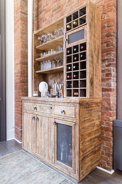 The home bar is made of reclaimed wood, there are open shelves and drawers - Eclectic Soho Loft With Vintage Finds And Industrial Touches