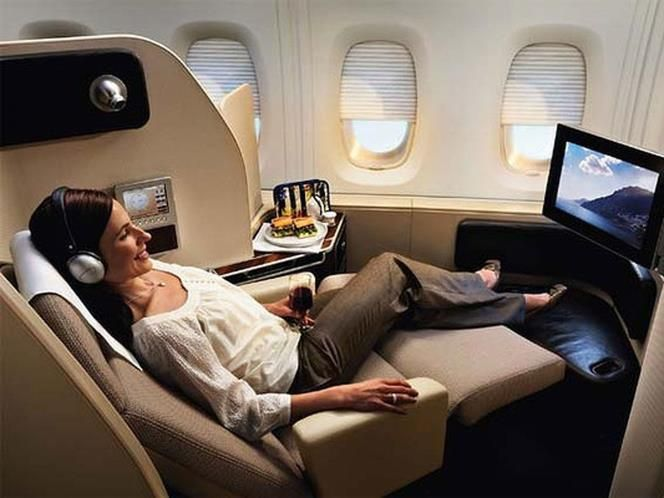 Qantas A380 First Class Suites Each Cosy Cocoon Like Suite Features An Expertly Designed Sea Flying First Class Business Class Flight Business Class Tickets