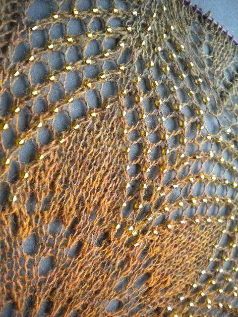 http://www.ravelry.com/projects/emmeke/in-dreams-mystery-shawl