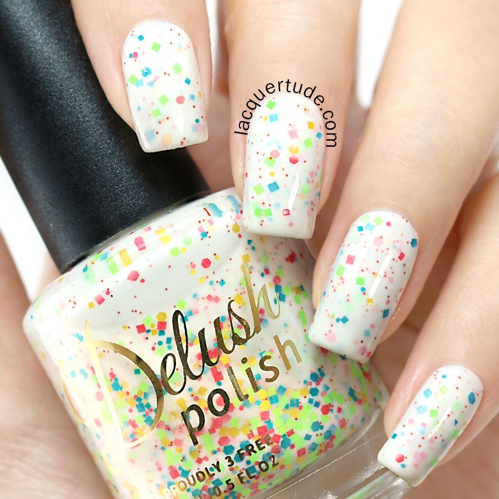 A creamy white crelly featuring a lively medley of various colored glitters that offers a playful twist to your average white nail polish! This listing is for a full sized 15ml bottle. Swatches: Lacqu
