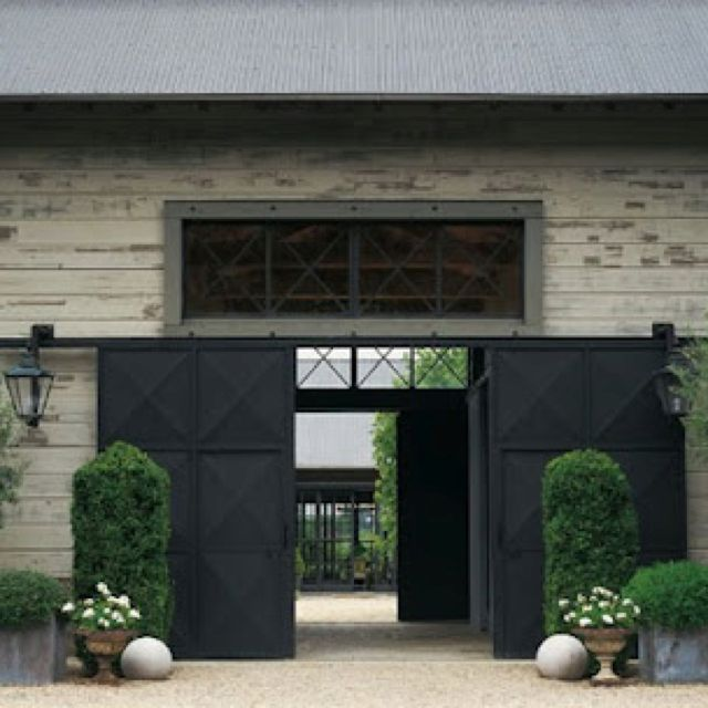 Black Sliding Barn Doors With Symmetrical Planting