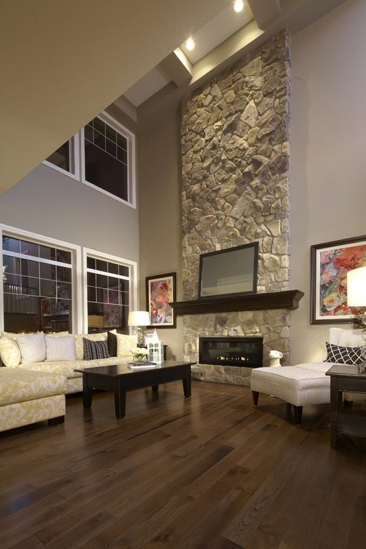 Living Room With High Ceiling And Fireplace. high ceiling ...
