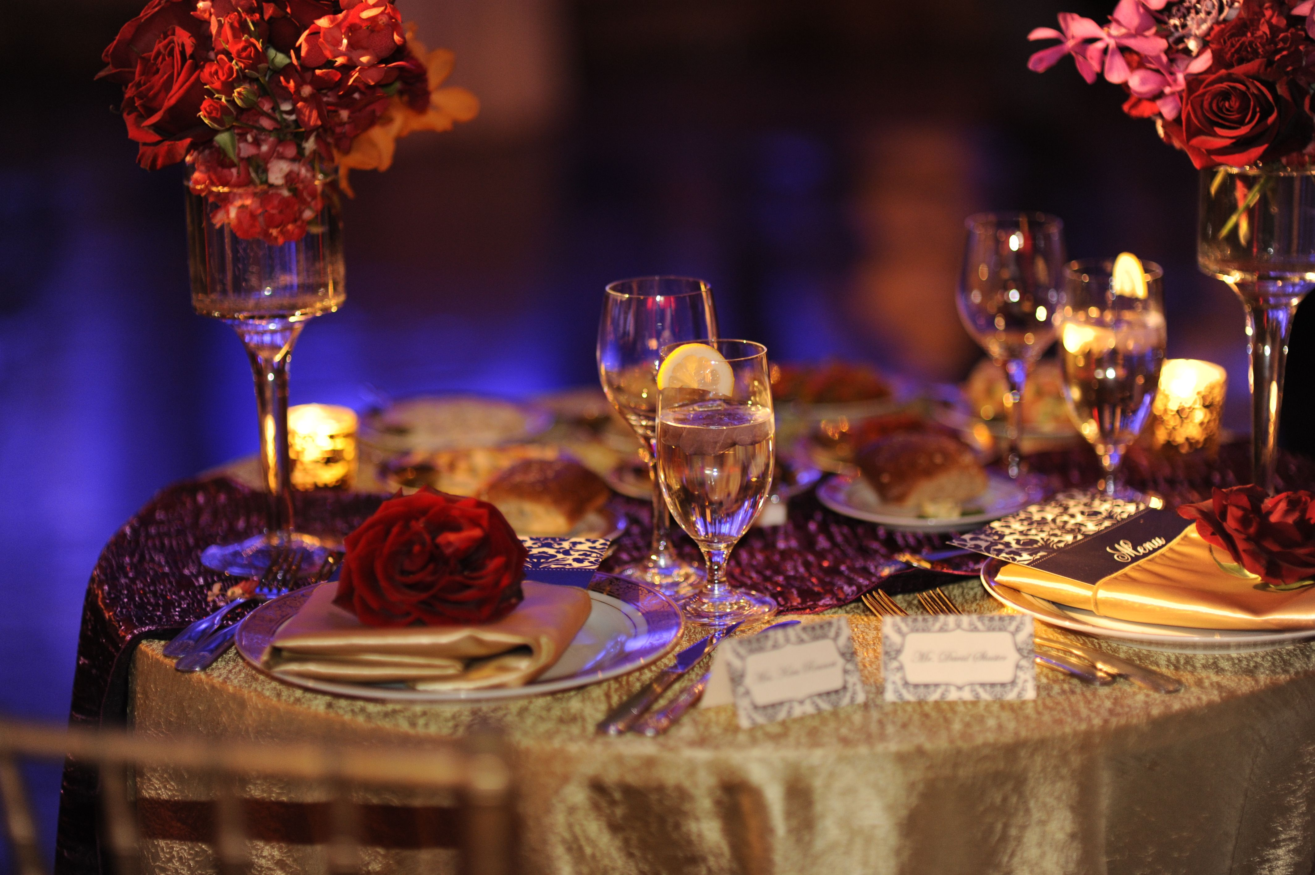 Wedding or Party Table Setting. Red, purple, pink, and orange ...