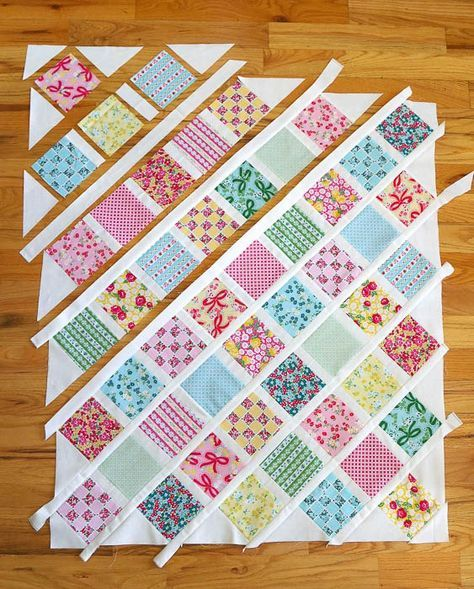 """Baby quilt tutorial - perfect for using 5"""" charm squares. Learn a new quilting skill - how to sew together patchwork squares on point."""