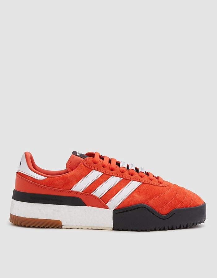 Classic soccer-boot inspired sneaker from Adidas in collaboration with Alexander  Wang in Bold Orange 941021dee