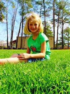 I am not sure what I like better, the cute little Julia or the green grass and the summer sky! :)