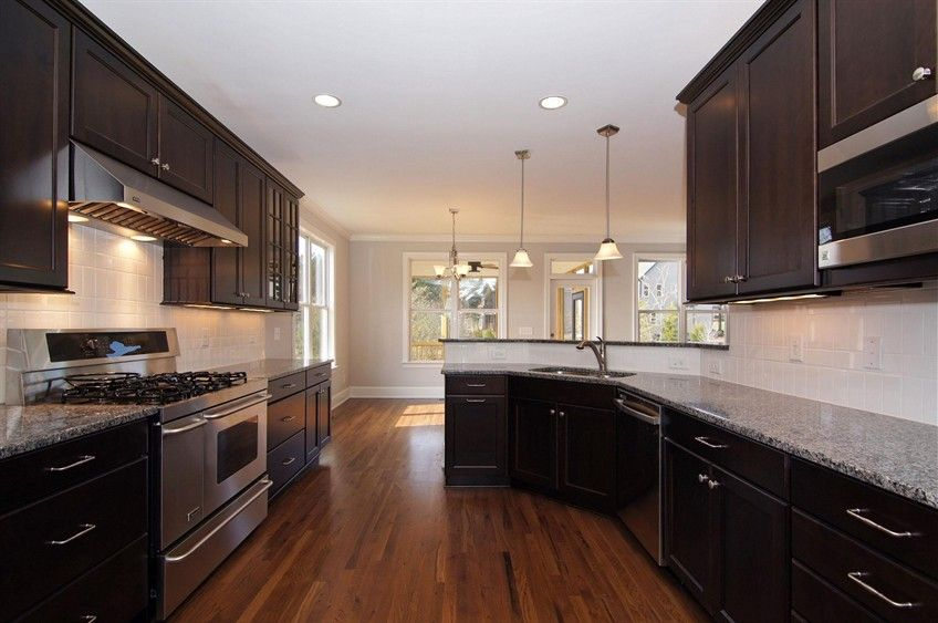 dark kitchen cabinets, white subway tile backsplash ...