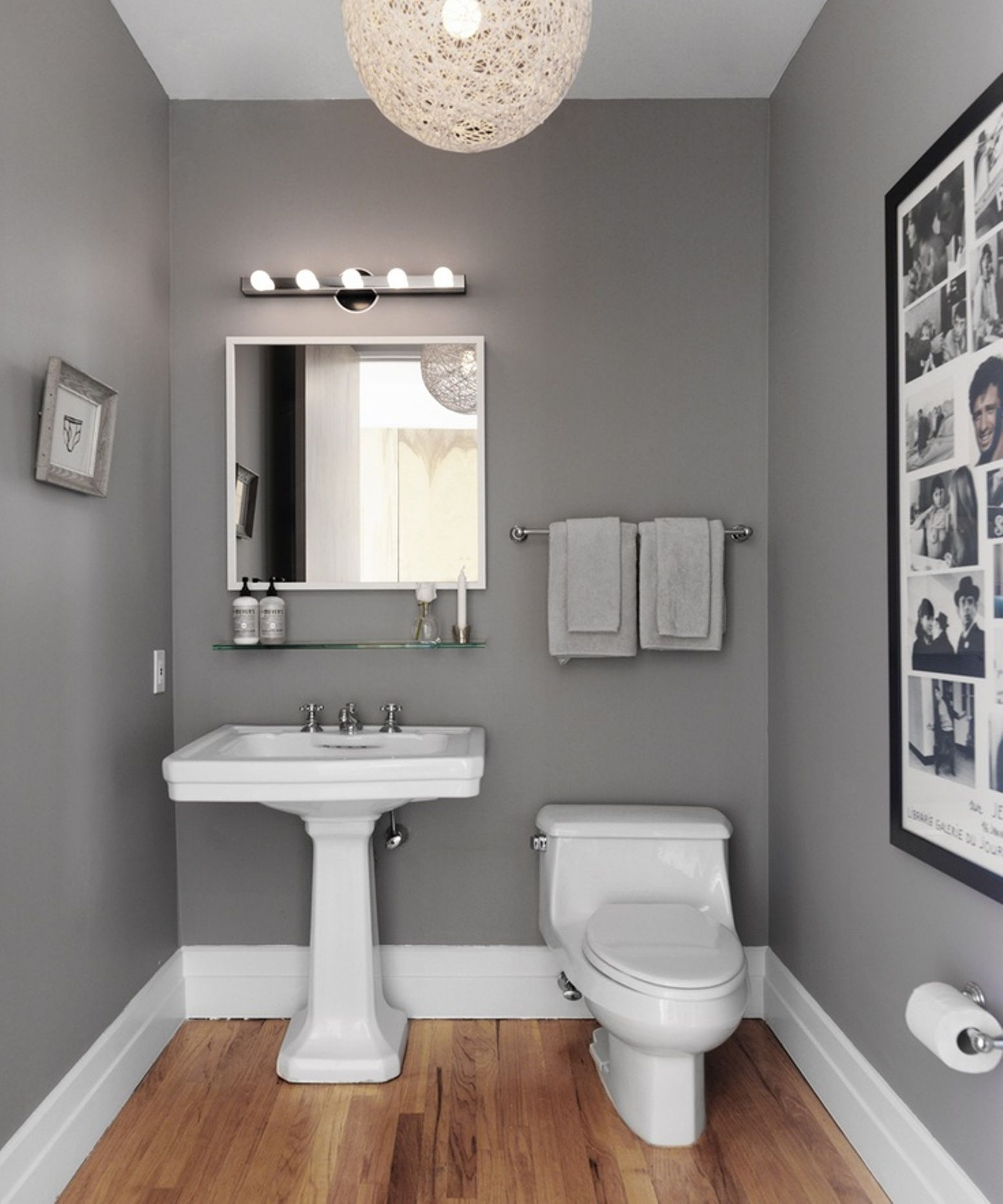 Bathroom paint grey - Modern Powder Room With Steel Gray Walls And White Twine Pendant Over Oak Hardwood Floors Gray Powder With White Square Mirror Over Vintage Glass Shelf And