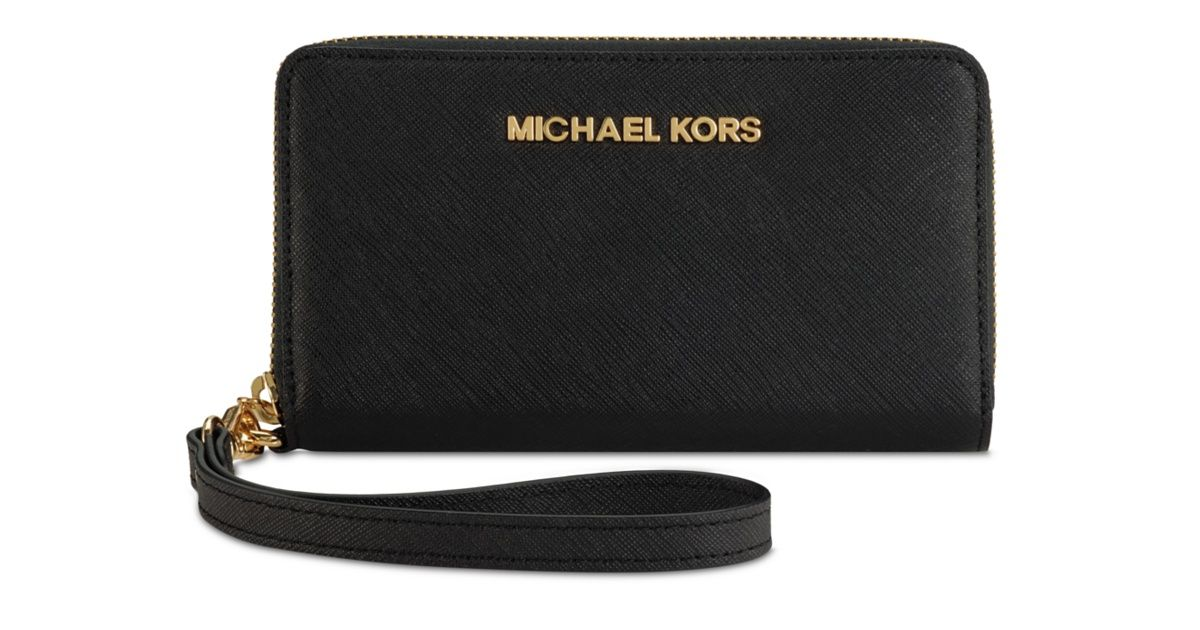 fdc042df1a4c The MICHAEL Michael Kors Essential Zip case combines an iPhone case and a premium  leather designer wallet perfect for ID, cash, and credit cards.