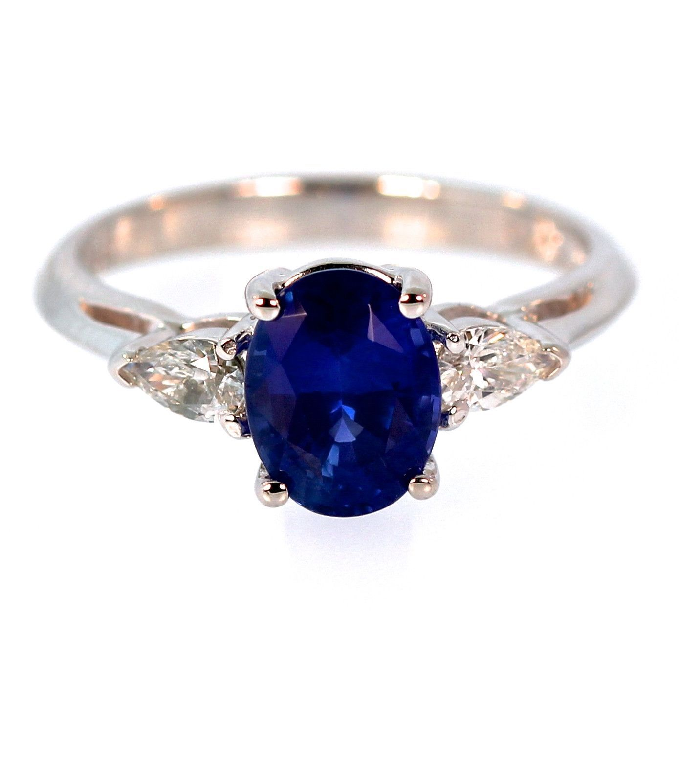 ring shaped j blue top r halo style pear sapphire