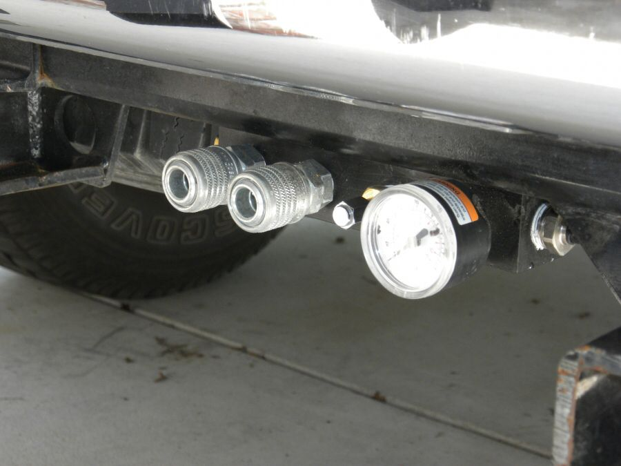 On board air compressor with outlets attached to the hitch