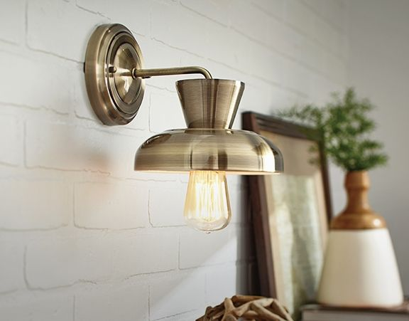 Canvas paxton wall sconce light adds a traditional feel to any room features an antique brass finish with a metal shade