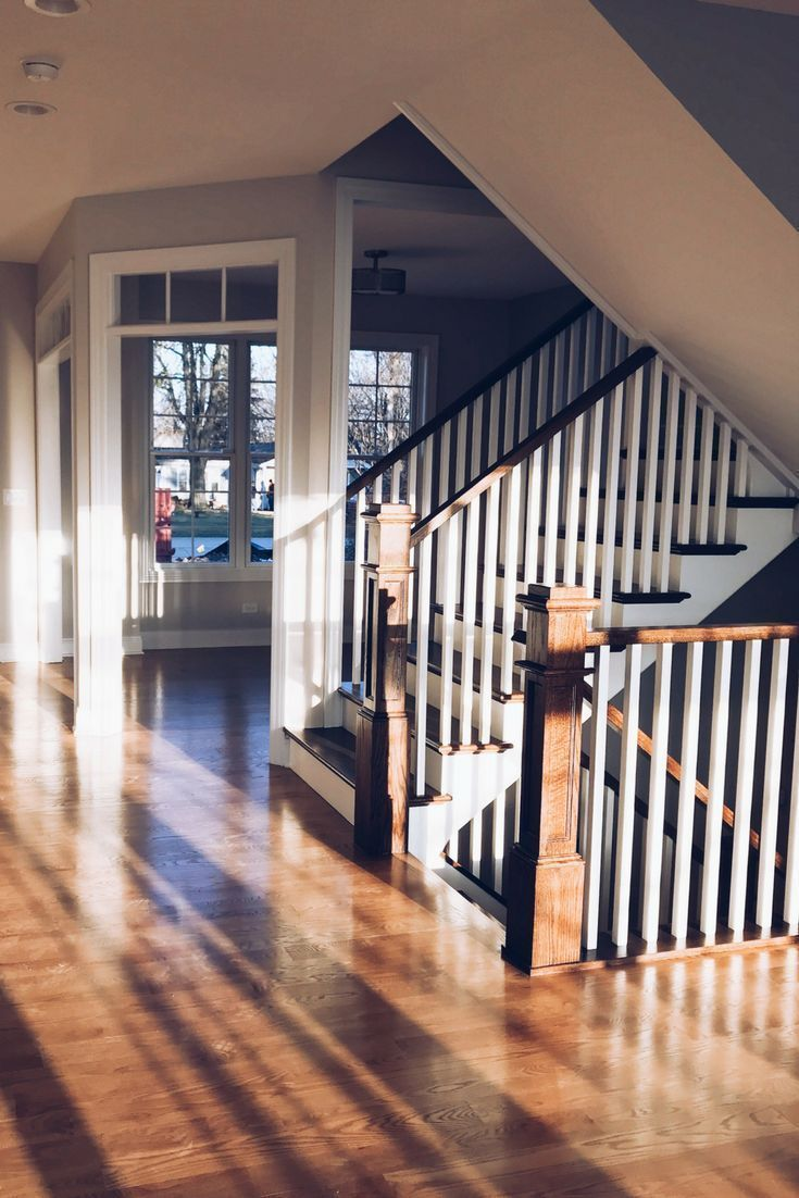 Red oak hardwood floors stained in weathered oak floor stain stairs
