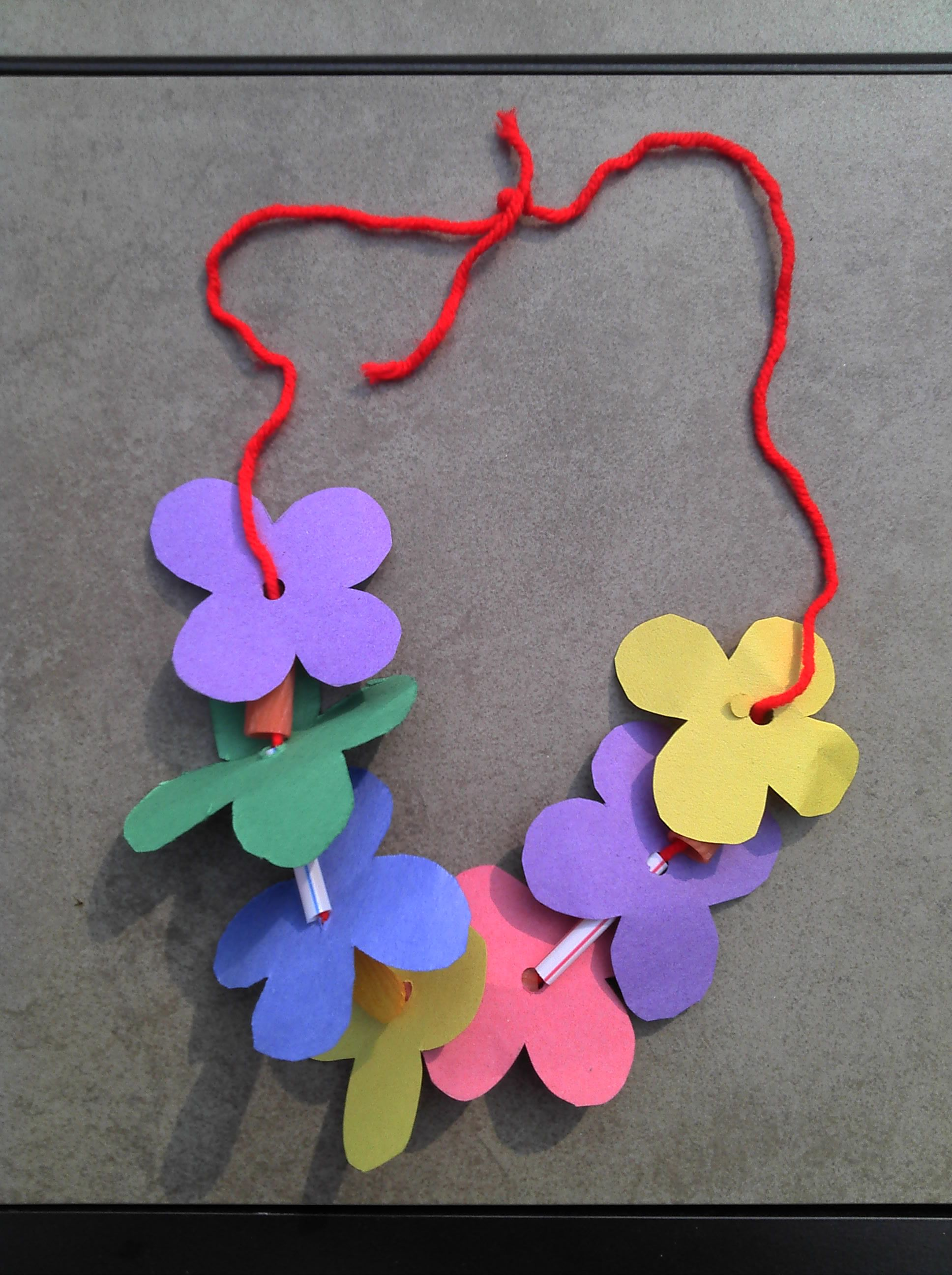 Lei can be made with construction paper yarn solid for Art and craft with paper easy