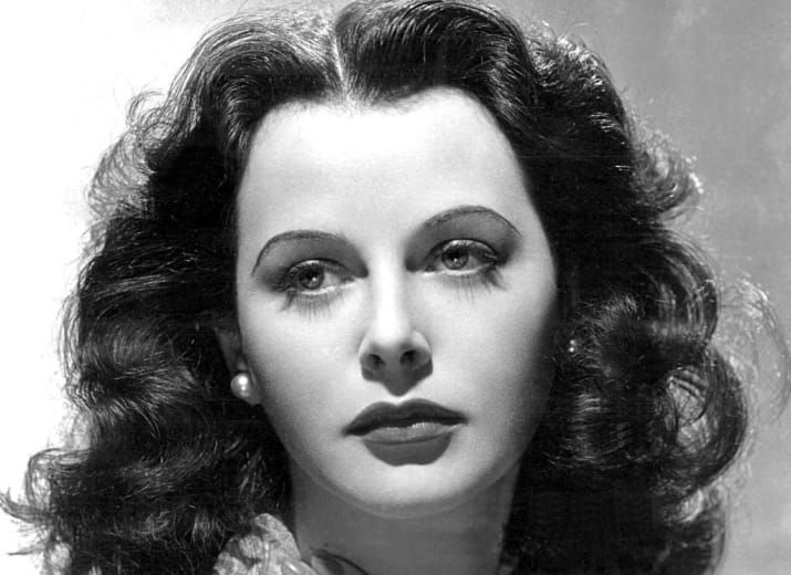 "Lauded as ""the most beautiful woman in the world,"" film actress Hedy Lamarr earned our eternal gratitude when she drafted a ""Secret Communications System"" during WWII — technology still used by cell networks, Bluetooth gadgets, and Wi-Fi."
