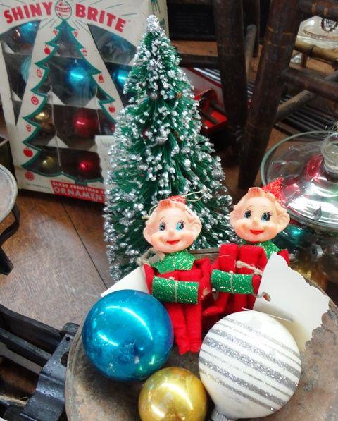 Vintage elves on a shelf, glass Christmas balls and bottle brush