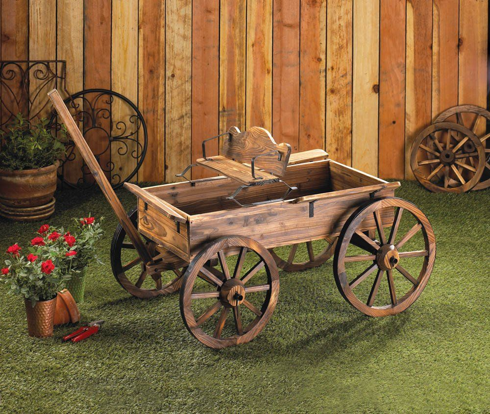 Old-time buckboard styling and a weathered finish give this cart the instant appeal of a cherished antique! Real rolling wheels add a charming touch and allow easy access to move things around your ga