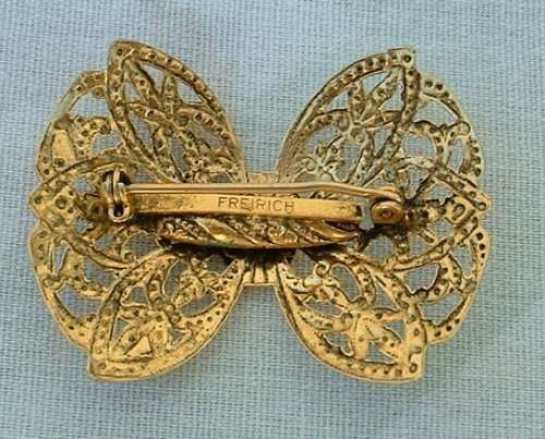 3dbc4f5040b This vintage pin has a lovely openwork pattern in a bow design with  detailed embossing, even in the center. It measures 1-1/2 x 1-1/4 inches  and is marked ...