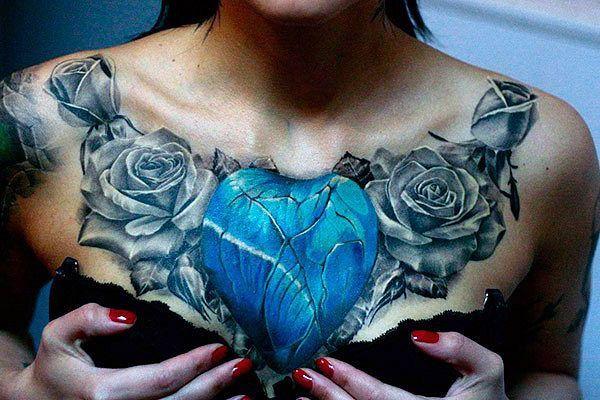 b6a542db6 women chest tattoo heart and roses | Tattoo sugar skulls | Chest ...