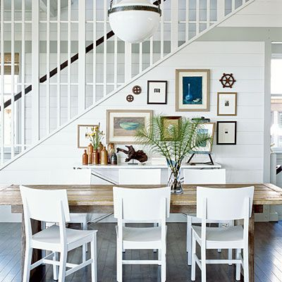 Coastal Living Idea House-dining room, wooden farmhouse table, gallery wall, hicks pendant