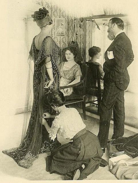 Les Createurs de La Mode 1910 - 12   (*I'm looking at the shop girl kneeling- striped skirt/layers of lace on her bodice & she has sturdy heels on*)