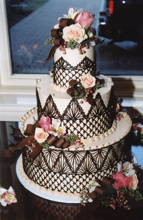 Cakes | Gallery | Julia Usher | Recipes for a Sweet Life       Something delicate in chocolate decorating. A Lacy Look. One of Julia's signature wedding cake styles is the chocolate lace wrap—premium chocolate piped freehand and wrapped around each cake tier. For technique details, click here.