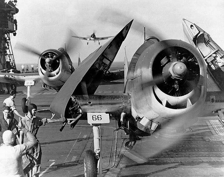 "US Navy F6F Hellcat fighters of VF-10 ""Grim Reapers"" of Carrier Air Group 10 landed on carrier Enterprise after attack on Truk February 1944."
