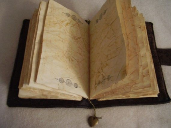 Gorgeous antiqued journal - crumpled pages, hand-bound.  It's beautiful - I want to write spells and secrets in it.  #book #journal