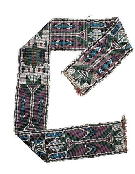 """WESTERN GREAT LAKES LOOM-BEADED SASH,  Price Realized: $558.13  Auction: 2009. American Indian Art, last quarter 19th century using colors of pony trader blue, cobalt, white, translucent green, rose, and pink; decorated with geometrics and central turtle, length 36"""".  From an English Collector  Condition: Light bead loss; finishing tassels missing."""