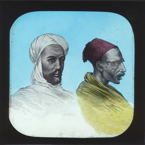 """The Mahdi and Zebehr Pasha. Slide 25 of Soudan War (lecture: York & Son, 57 slides, 1880s). From 1881-85 Muhammed Ahmed proclaimed himself the Mahdi and established what could be described as the first modern Islamist state in Sudan. His fanatical followers, nicknamed """"fuzzy-wuzzies"""", held their own against the more advanced British, Egyptian and Ethiopian armies, and weren't defeated until 1898."""