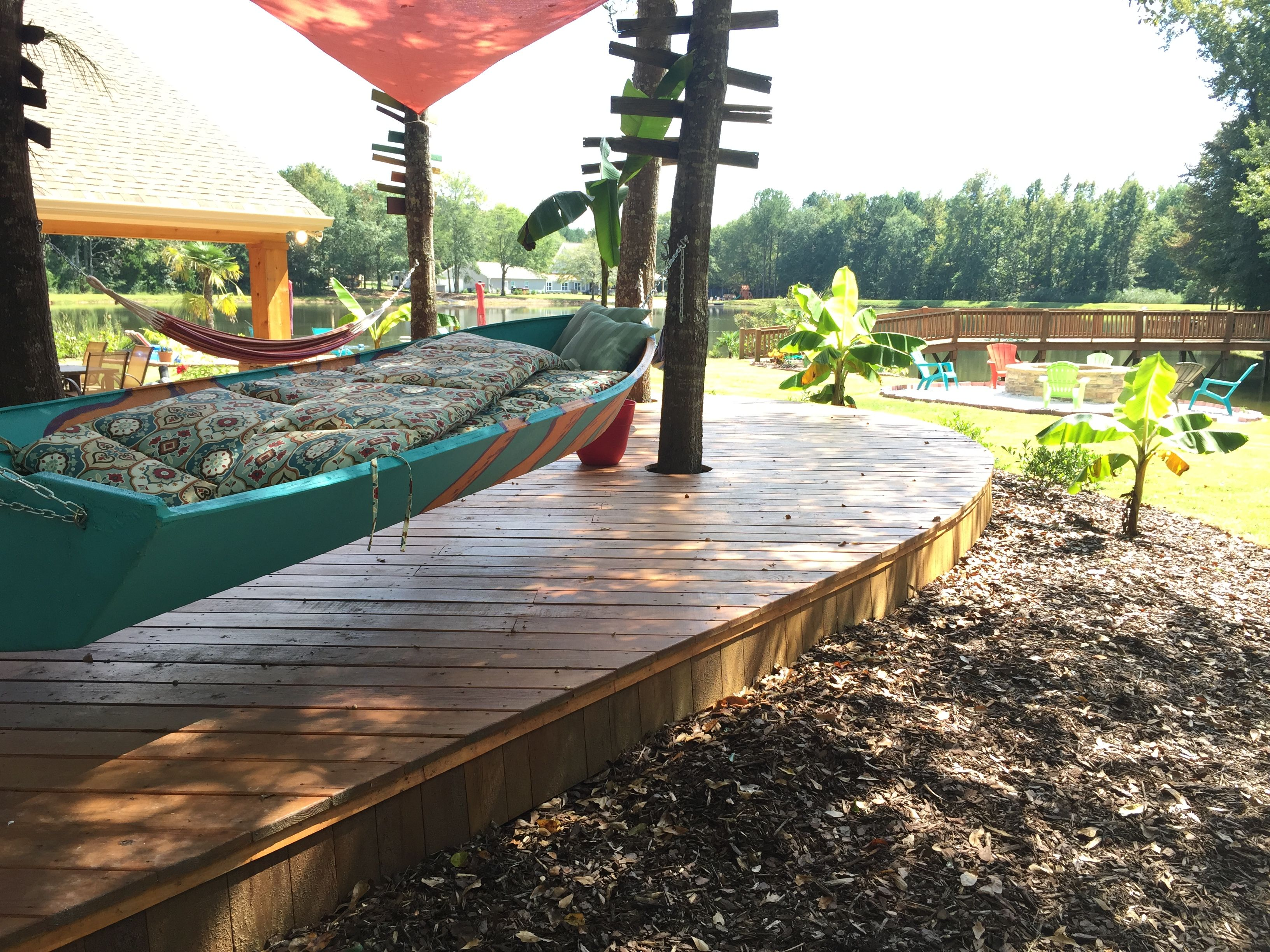 Love the boat hammock swing so tropical a tiki bar looking