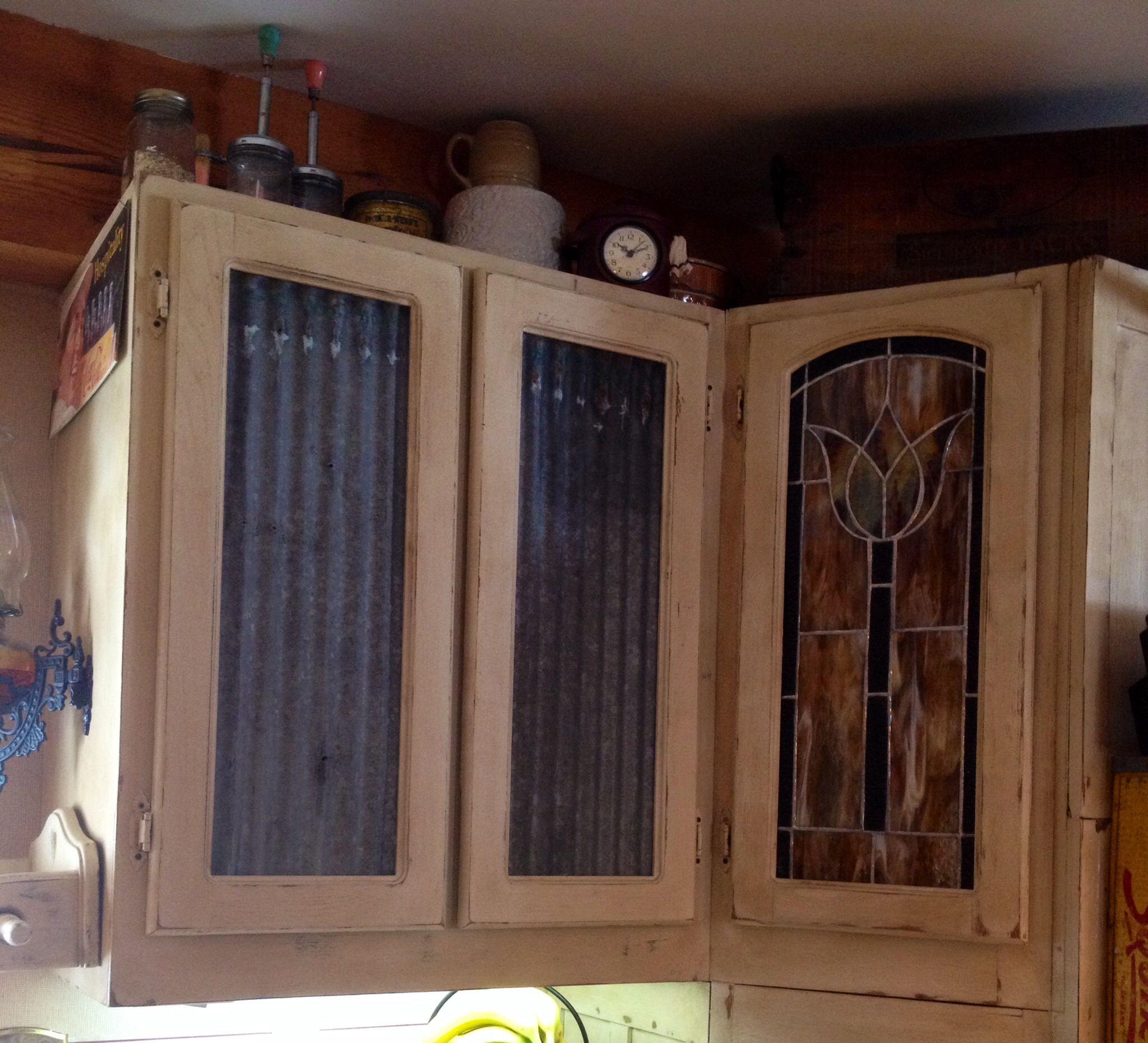 Old galvanized roof panels for door inserts. Diy