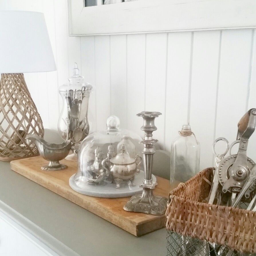 Vintage silver collection clustwred under modern fresh glass ...