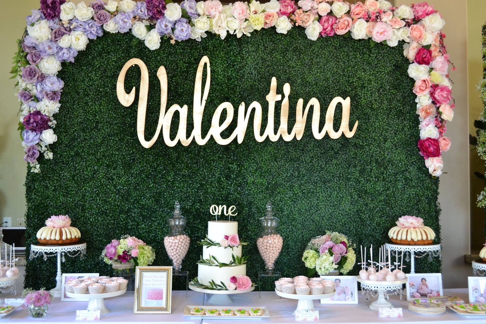 Garden theme party with hedge wall and florals | Garden party ...