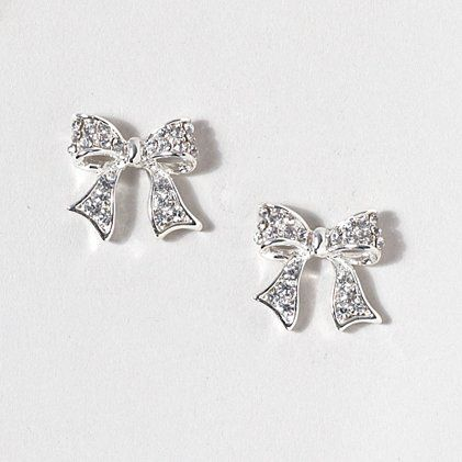 0bd5e323a Silver and Crystal Bow Stud Earrings | Claire's. | Material ...