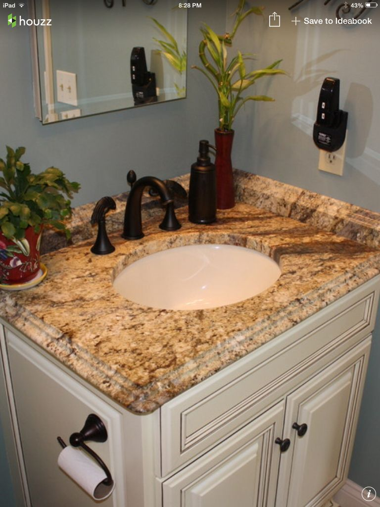 Golden River Granite Bronze Fixtures Painted White Cabinets