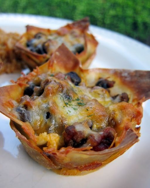 """Taco """"Cupcakes """"by Plain Chicken""""  I kept this pretty simple. I used my basic taco meat recipe and just added some black beans.  You could add some green peppers or olives if you really wanted to jazz it up. We topped the cupcakes with somehomemade salsa and sour cream."""