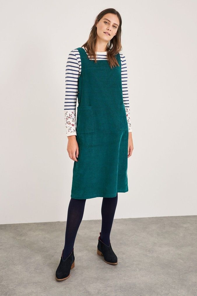 A cord pinafore dress made from 100% cotton in a longline design with a square neckline and front pockets   easy styling, any day of the week.  100% Cotton.