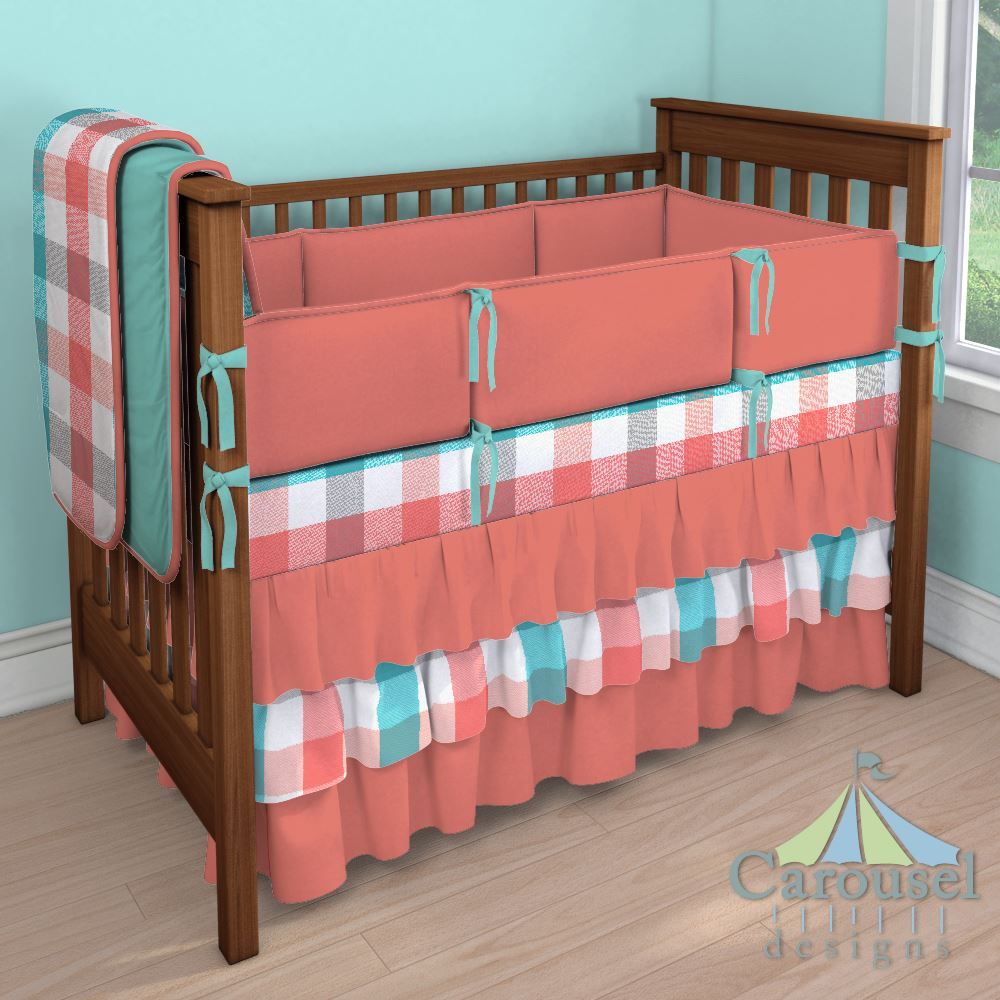 Crib bedding in Coral and Teal Buffalo Check, Solid Coral, Solid Teal. Created using the Nursery Designer® by Carousel Designs where you mix and match from hundreds of fabrics to create your own unique baby bedding. #carouseldesigns