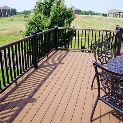 Timbertech fully composite deck with tt radiancerail express decking is terrain in brown oak and