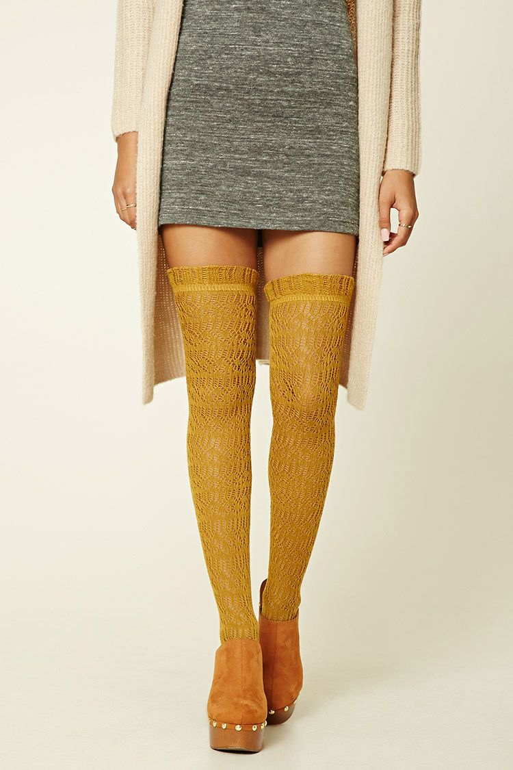 A pair of over-the-knee knit socks featuring a pointelle knit design and ruffled trim.