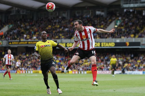 John O'Shea of Sunderland clears the ball from Odion Ighalo of Watford during the Barclays Premier League match between Watford and Sunderland at Vicarage Road on May 15, 2016 in Watford, England.