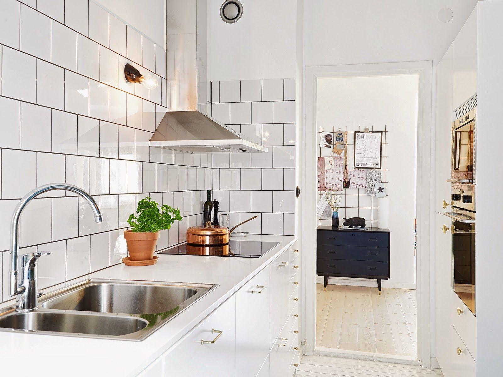 a cool funkis style apartment in gothenburg white tile kitchenkitchen subway